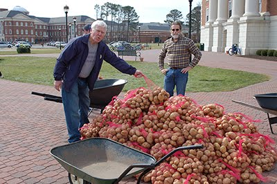 Bill Lamont, and Kip Redick (also faculty advisor), help tote the potatoes to the trucks.
